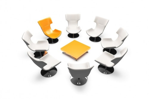 unformal meeting with orange chairs